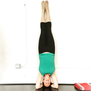 Nicole doing a headstand at yoga