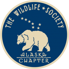 Logo for the Alaska Chapter of The Wildlife Society. The logo shows a gold-colored polar bear on a dark blue background. Eight gold stars in the shape of the Big Dipper constellation are above the polar bear.