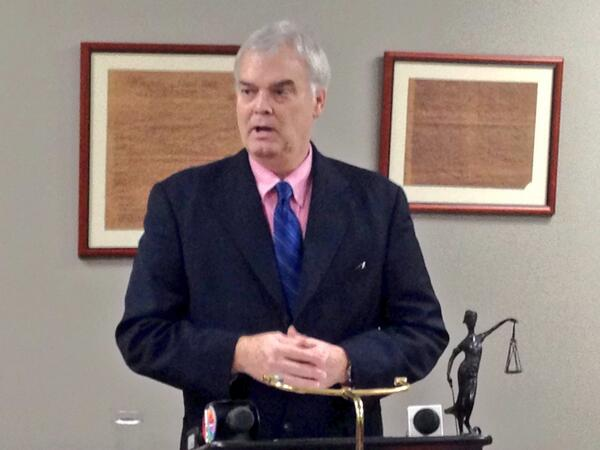 Mike speaking at a news conference