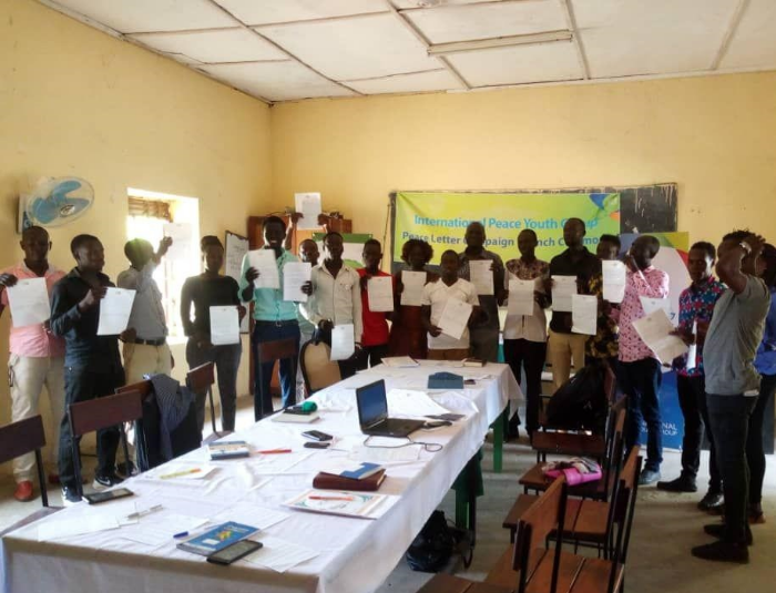 The Youth of South Sudan hold up the pen for peace instead of guns