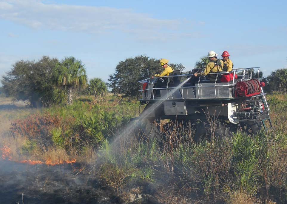 Seminole Firefighters spray down a fire in Florida