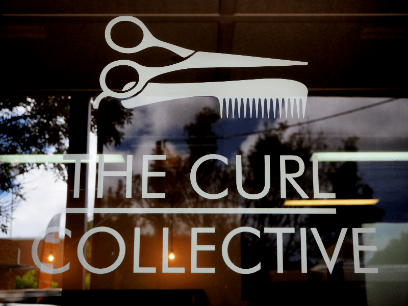 The Curl Collective logo on front door