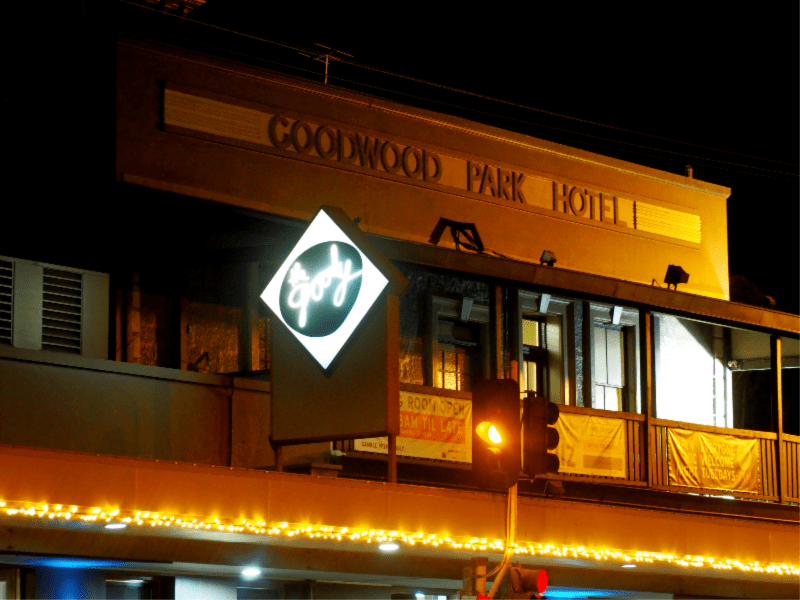 Exterior of The Goody Hotel at night