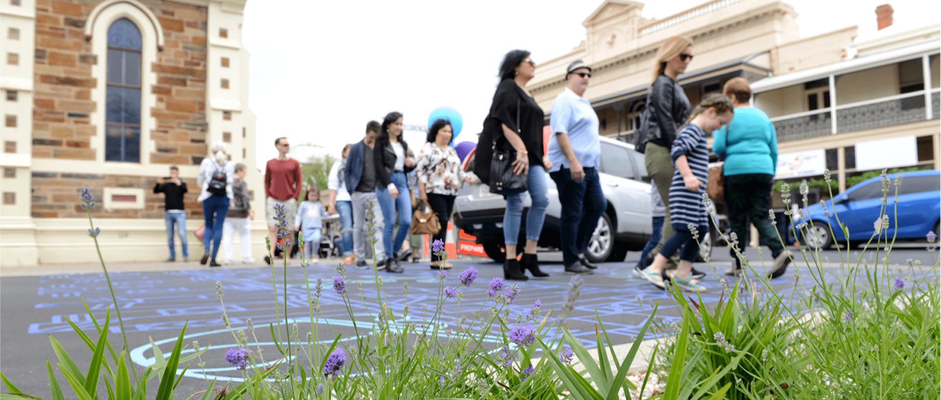 People walking across a road