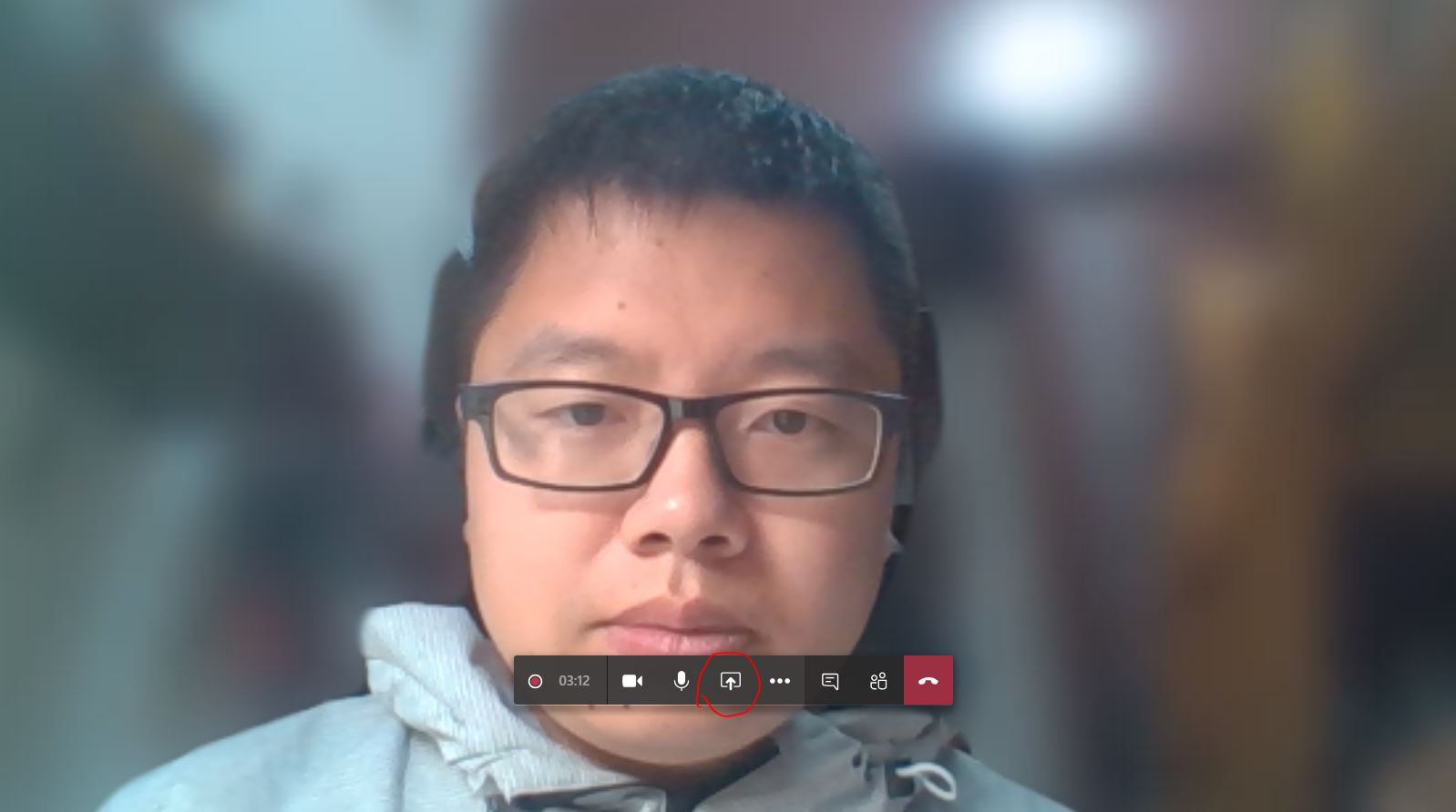 A person wearing glasses and looking at the camera  Description automatically generated