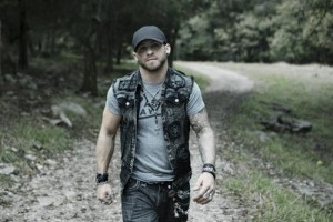 Brantley Gilbert walking on a dirt road