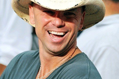 Kenny Chesney gives fan a push after he jumps on stage