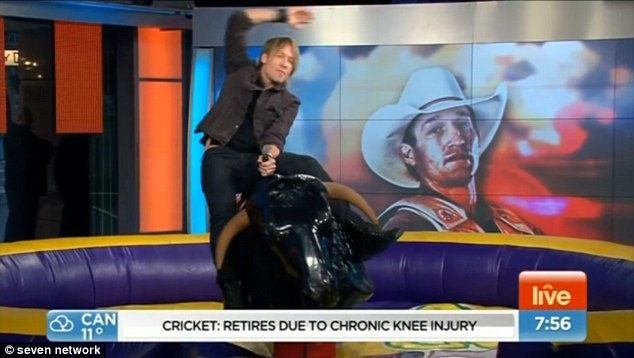 Things don't go well when Keith Urban tries riding a mechanical bull