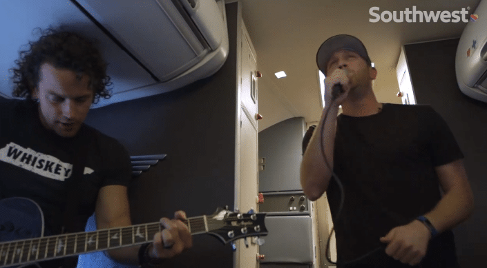 Watch Cole Swindell perform for lucky fans on a plane