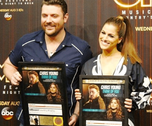Chris Young Surprises Cassadee Pope At CMA Fest Press Conference
