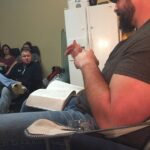 Brew Pastor Brandon reading from the Bible