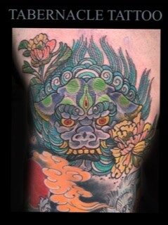 Traditional japanese foo dog and floral color leg tattoo