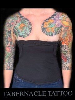 Traditional japanese women floral and hannya mask half sleeves tattoo