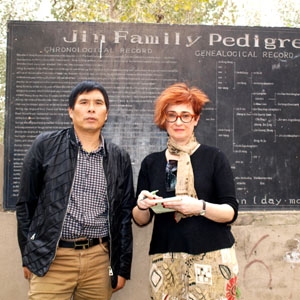 Irene Shaland and Mr. Jin at Jewish Cemetery in Kaifeng, China