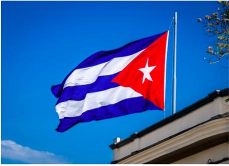 Cuban flag against blue sky