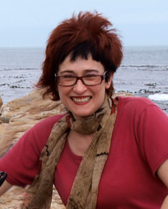 Irene Shaland standing at Cape of Good Hope, South Africa