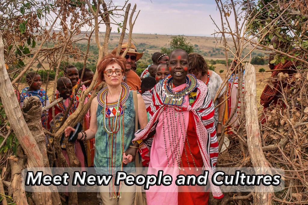 Irene Shaland enters Masai village surrounded by Masai Women