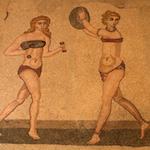 Girls playing a ball mosaic in Villa Romana