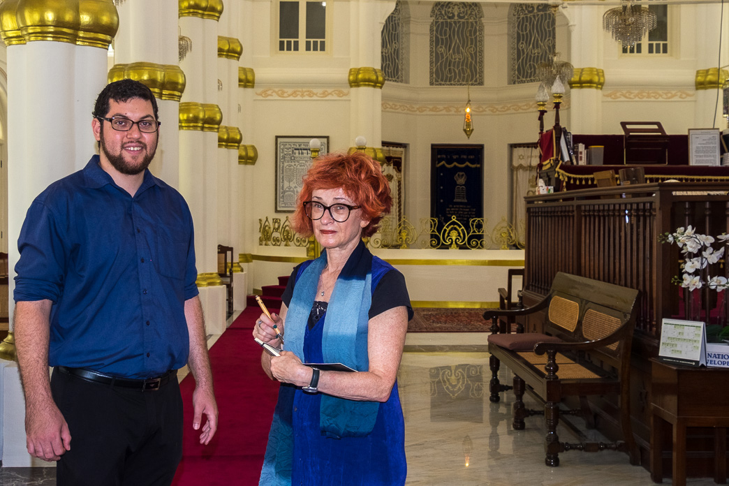 Irene Shaland and Rabbi inside Chesed-El Synagogue