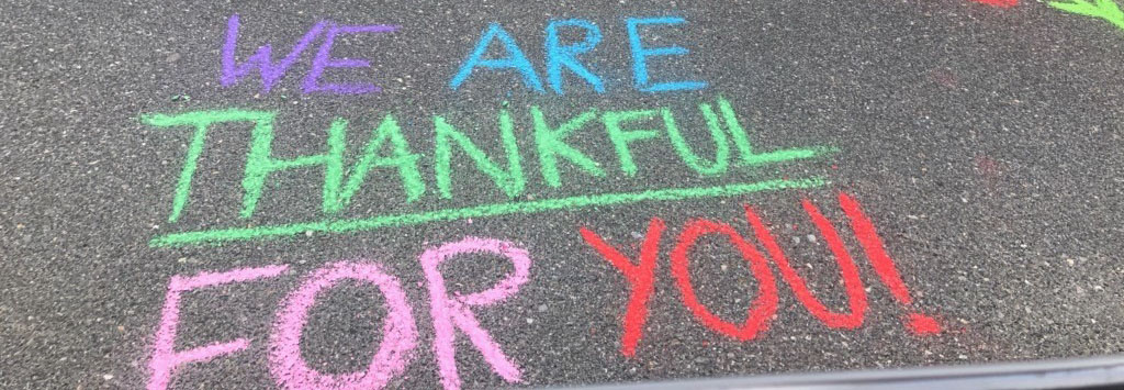 Thankful to all workers written in chalk