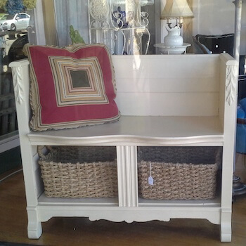 A Classic Beauty, This Bench has a Curved Seat & Baskets for Storage