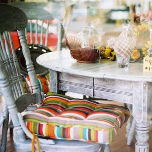 dining room table and chairs in aged white