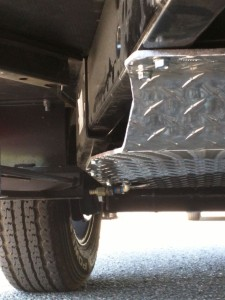 Front skid plate, from passenger side, note the cutout for water drain near the back