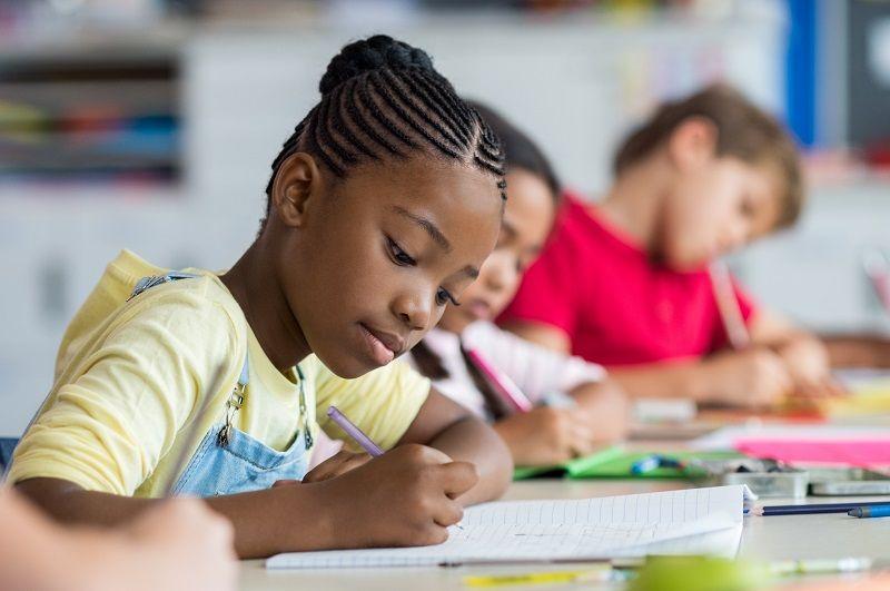 School-girl-writing-in-class-cm