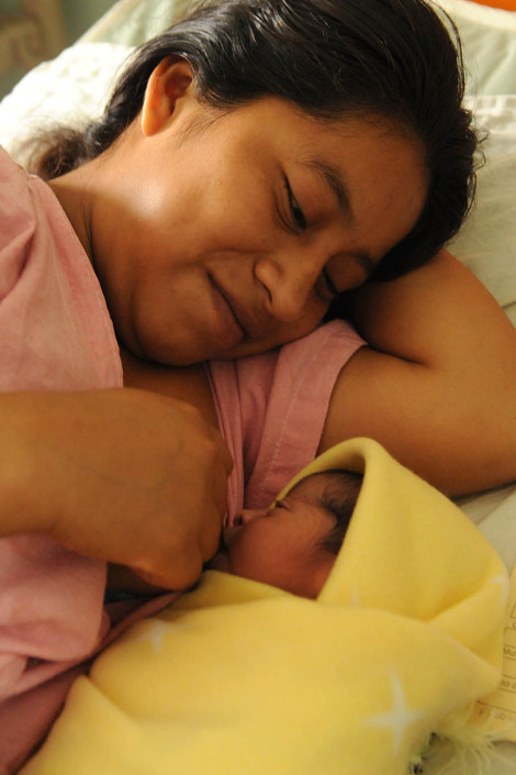 An indigenous Mayan woman breastfeeds her newborn daughter in the maternity ward of Coban Hospital in Guatemala.