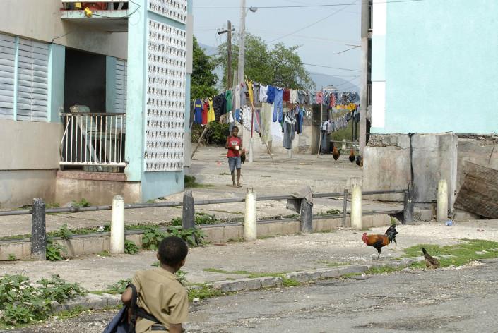 A boy walks home from school as another boy walks toward him in Rema, Kingston, Jamaica.