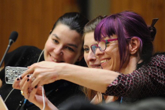 Women participate in a meeting at the UN.