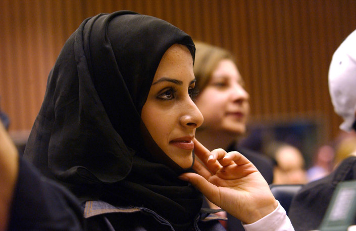 Qatari child delegate wearing a head covering at the UN.