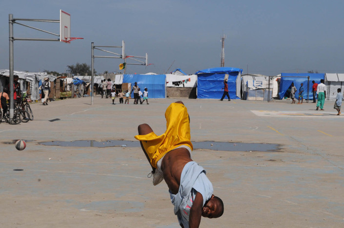 A boy plays at Carrefour Aviation, a tent camp housing 50,000 people who were displaced by the 7.3 magnitude earthquake on 12 January in Haiti.