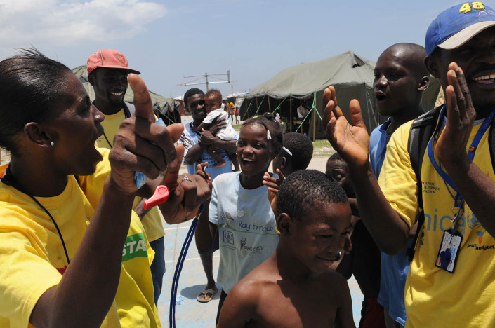 Children participate in organized games at Carrefour Aviation, a tent camp housing 50,000 people who were displaced by the 7.3 magnitude earthquake on 12 January in Haiti.