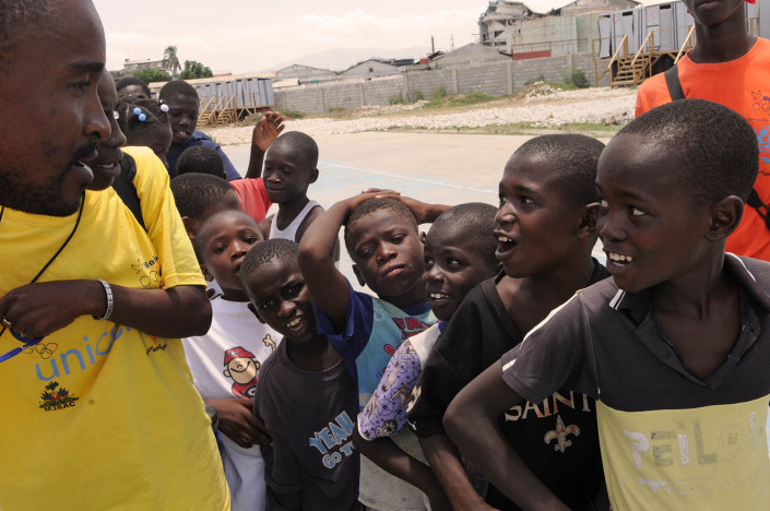 Boys participate in organized games at Carrefour Aviation, a tent camp housing 50,000 people who were displaced by the 7.3 magnitude earthquake on 12 January in Haiti.