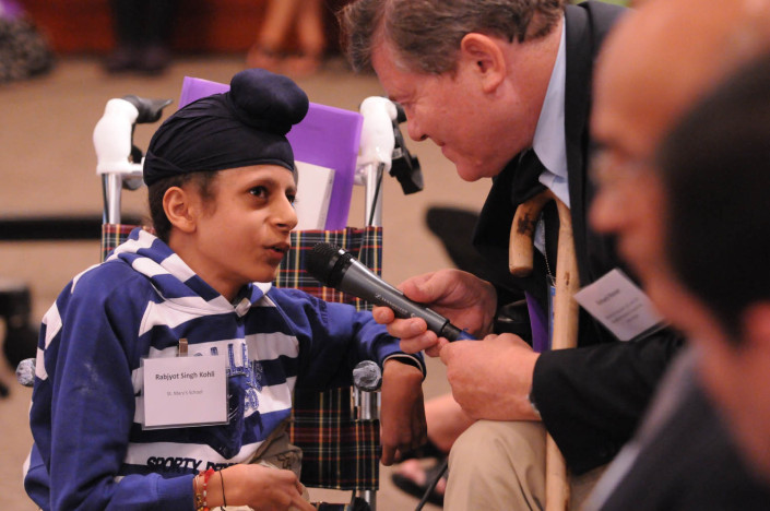 A child delegate addresses a disabilities conference