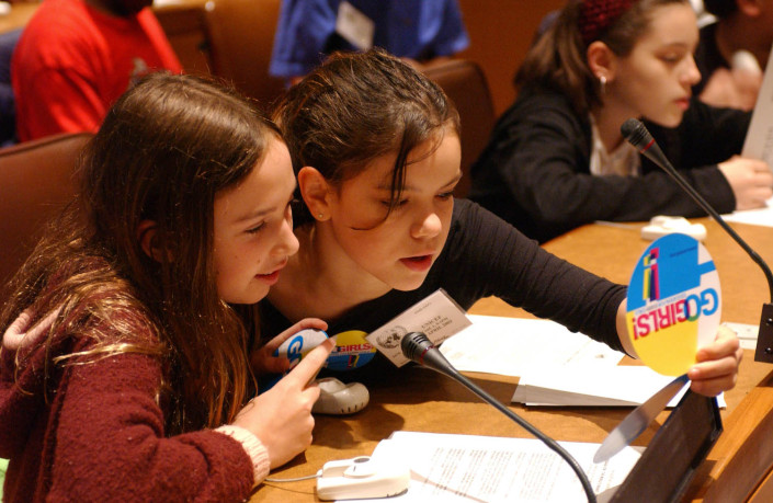 Young girls participate in a meeting at the UN.