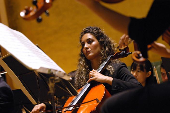 An adolescent girl plays the cello at the UN.