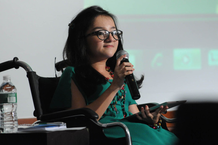 Disabilities activist Phuong Anh (Crystal) participates in a meeting at UNICEF Headquarters.