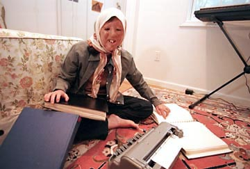 Sara studies with a Perkins Brailler