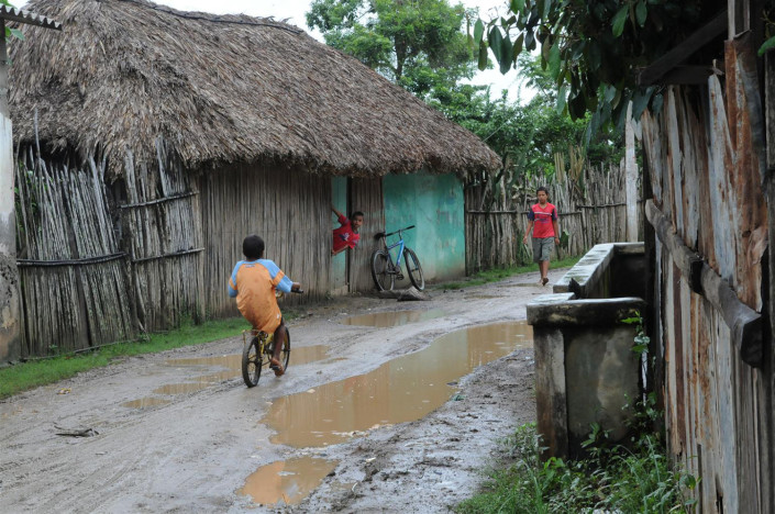 Children play outside on a flooded street in northern Colombia.