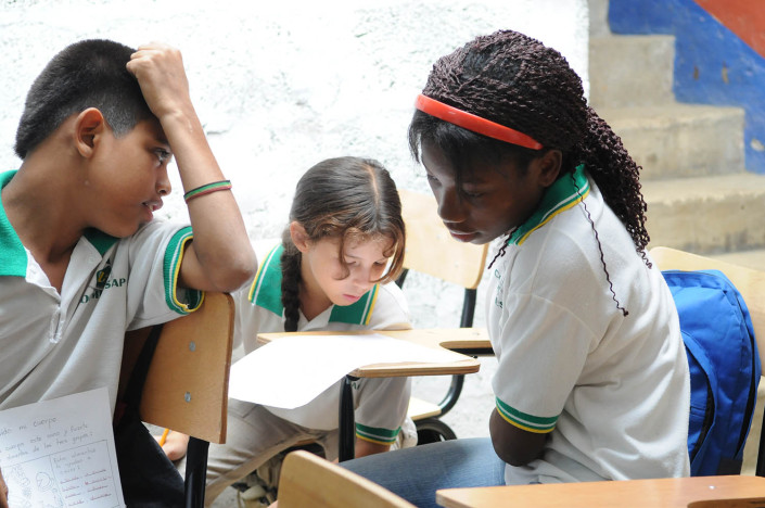 Students work together in a third-grade science class in Medillin, Colombia.
