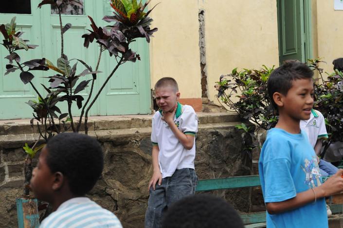 A boy is bullied outside a school in Medellin, Colombia.