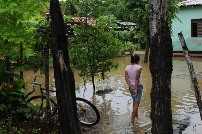 A girl walks through her flooded yard in northern Colombia.