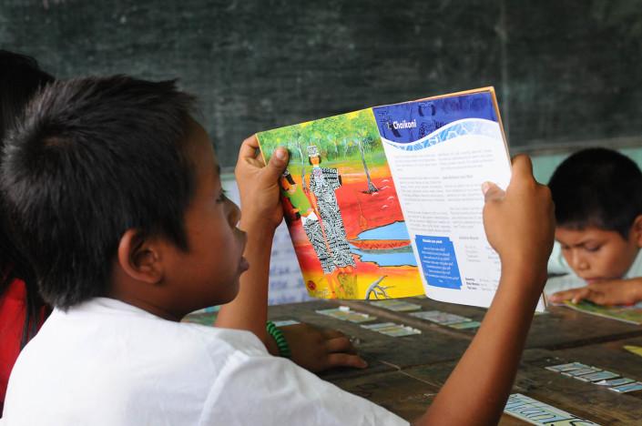 A boy reads a book in a language class in the indigenous Shipibo-Conibo community of Nuevo Saposoa in the Peruvian Amazon.
