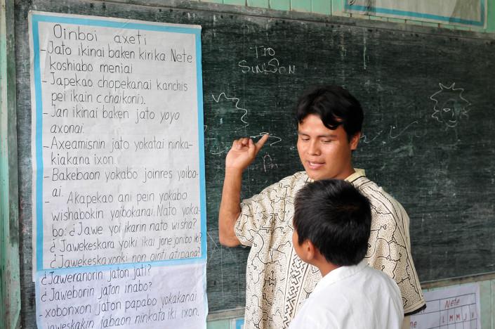 A teacher instructs a student in Shipibo, in the indigenous Shipibo-Conibo community of Nuevo Saposoa in the Peruvian Amazon.