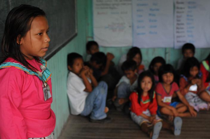 A girl stands inside a classroom in the indigenous Shipibo-Conibo community of Nuevo Saposoa in the Peruvian Amazon.
