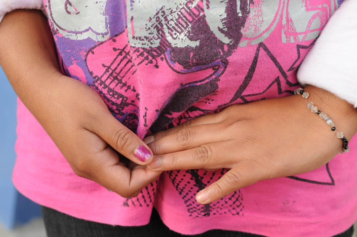 Portrait of a girl's hands in Guatemala.