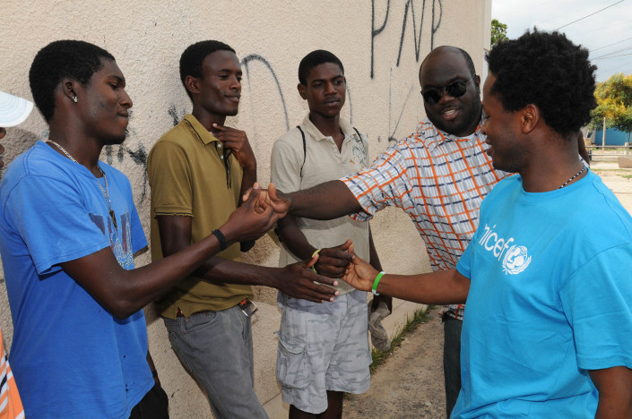 Former child soldier and author Ismael Beah speaks with youth in Jamaica.