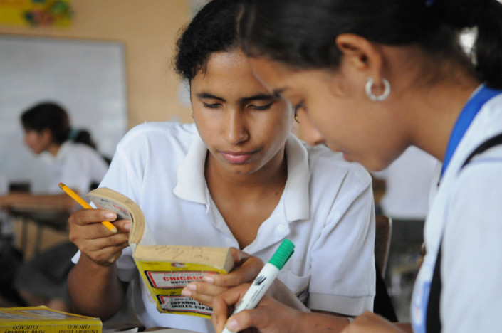 Adolescent girls study English in their 11th grad class in Lorica, Colombia.